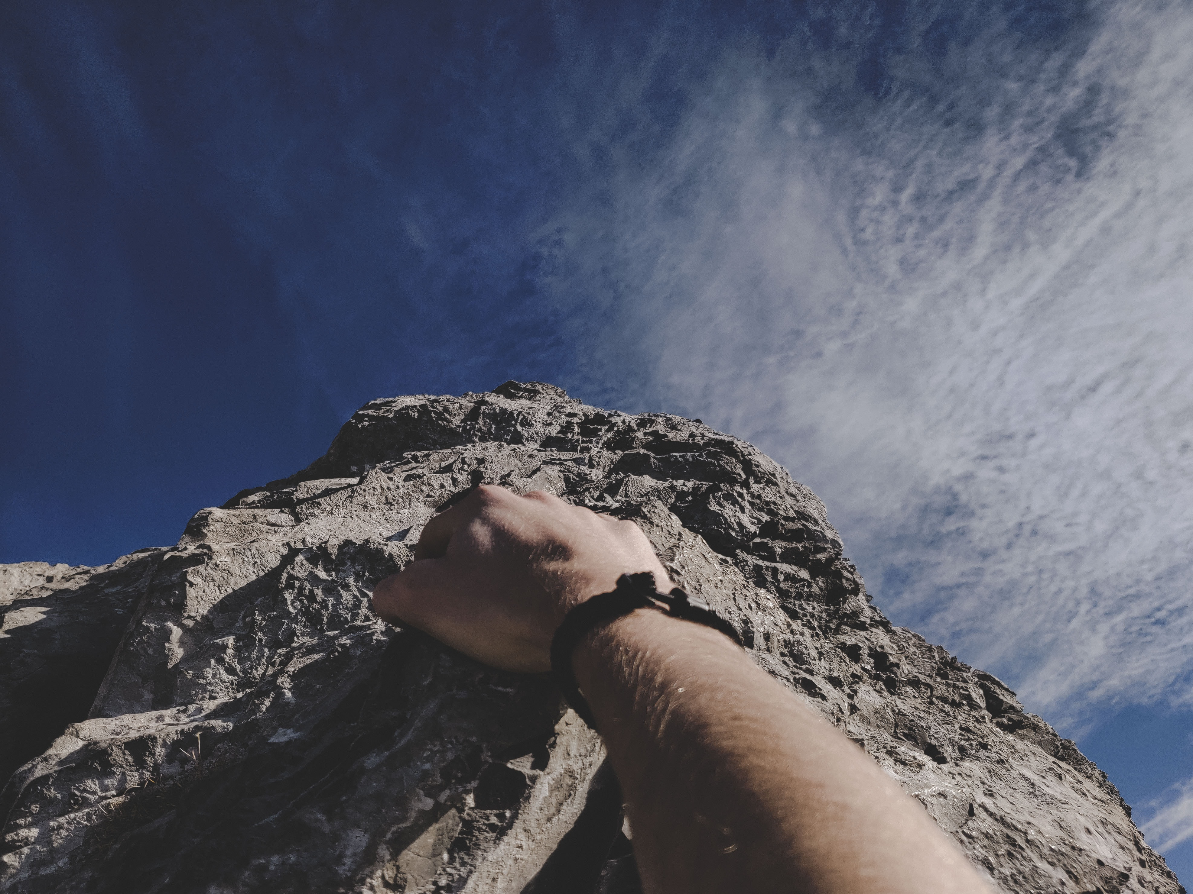 Picture of hand climbing up a mountain