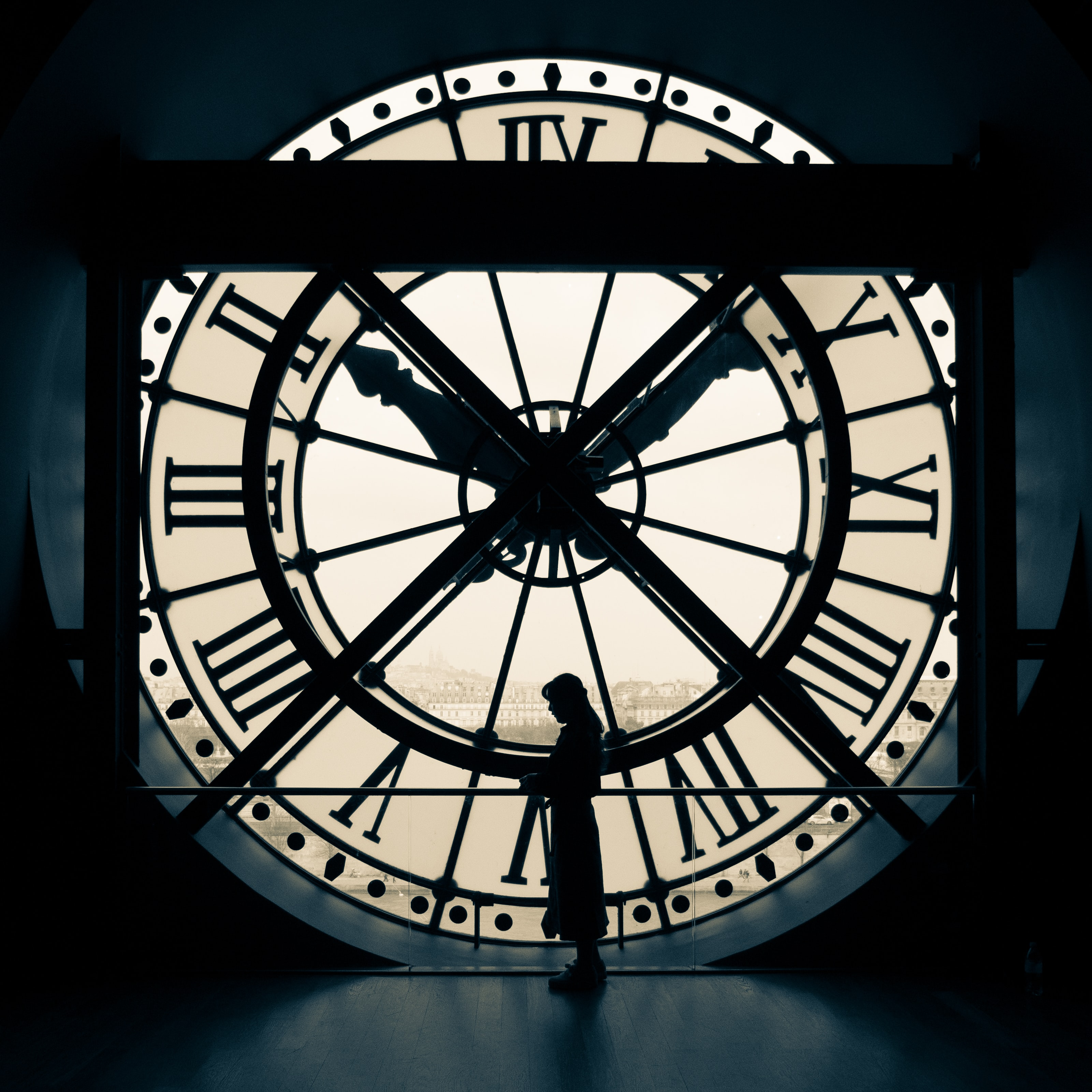 girl in front of clock